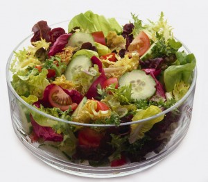 Salad with cucumbers, radishes, tomatoes